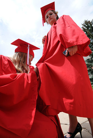"Mariah Wisner, left, helps Melissa Schriener with her gown before the ceremony.<br /> For more photos and a video of Fairview, go to  <a href=""http://www.dailycamera.com"">http://www.dailycamera.com</a>.<br /> Cliff Grassmick / May 20, 2012"