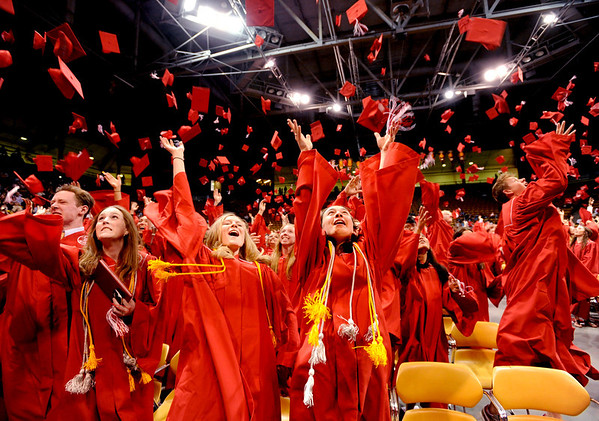 "Ayana Otteman, left center, and Erika Petroy, join their Fairview High School classmates in throwing their caps up to celebrate their graduation.<br /> For more photos and a video of Fairview, go to  <a href=""http://www.dailycamera.com"">http://www.dailycamera.com</a>.<br /> Cliff Grassmick / May 20, 2012"