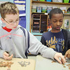 Chase Plausky, 11, and his classmate Waldy Jean-Charles, 11, count out some change in their classroom at Fall Brook Elementary School on Tuesday morning. Christine Lay's fifth grade class at Fall Brook Elementary School in Leominster held a Coin War for a Cure, challenging other classes to raise money for the National Multiple Sclerosis Society. The school raised over $3,000. SENTINEL & ENTERPRISE/JOHN LOVE