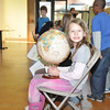 Jillian holds the globe for the special morning assembly.