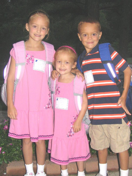 Caroline (2nd grade), Elizabeth (Kindergarten), and Jackson (2nd grade) waiting for the bus on the first day of school.<br /> Monday, August 14, 2006