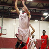 Fitchburg High School Basketball team played South High School on thursday night. FHS's Jose Hernandez puts up a shot. SENTINEL & ENTERPRISE/ JOHN LOVE