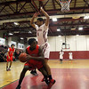 Fitchburg High School Basketball team played South High School on thursday night. FHS Tyri Hampton puts some defense on SHS's Khalil Bryan-Robinson. SENTINEL & ENTERPRISE/ JOHN LOVE