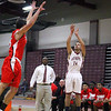 Fitchburg High School Basketball team played South High School on thursday night. FHS's Anthony Salome put up a three point shot. SENTINEL & ENTERPRISE/ JOHN LOVE