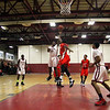 Fitchburg High School Basketball team played South High School on thursday night. FHS player Ray Williams puts up a shot at the end of the second quarter. SENTINEL & ENTERPRISE/ JOHN LOVE