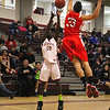 Fitchburg High School Basketball team played South High School on thursday night. SHA player Elgin Johnson ties to block a shot by FHS Manny Payton during action in the first half. SENTINEL & ENTERPRISE/ JOHN LOVE
