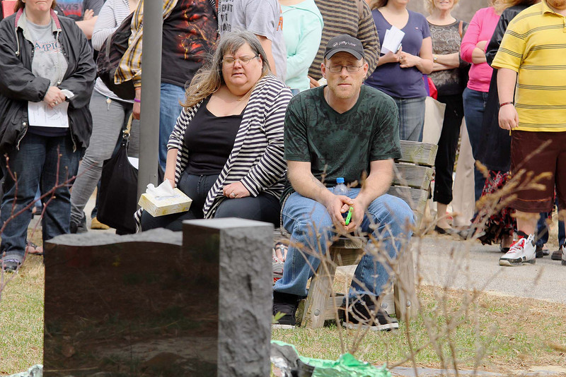 Fitchburg High School held a memorial for 53 East St. fire victim Christopher Brinkley a 2010 graduate of the High School. Brinkley's Mom Karen Gravell-Huckins and his step dad Frank Huckins sit on a bench in the Memorial Garden at the school where they are going to put Brinkley's name on a stone in the garden. SENTINEL & ENTERPRISE/JOHN LOVE