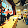Fitchburg High School students raise their hands to answer a question about drugs during an interactive game-show style assembly put on by MOC Peer Educators, including (group at right from left) Marymar Perez, 17, of Goodrich St. Academy School, Robert Aguero, 16, of FHS, and Analuisa Herrera, 17, of Monty Tech, Tuesday. The event was part of the National Drug Facts Week and served as a way to raise awareness about the scientific risks that substance abuse and addiction pose on personal health.<br /> SENTINEL & ENTERPRISE / BRETT CRAWFORD