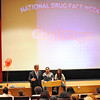 District Attorney Joseph D. Early, Jr. talks to Fitchburg High School students during an assembly put on by MOC Peer Educators, including Analuisa Herrera (center), 17, of Monty Tech, and Marymar Perez (right), 17, of Goodrich St. Academy School Tuesday. The event was part of the National Drug Facts Week and served as a way to raise awareness about the scientific risks that substance abuse and addiction pose on personal health.<br /> SENTINEL & ENTERPRISE / BRETT CRAWFORD