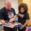 Class advisor Mark Pierce and senior Whitney Bailey look over old yearbooks in the alumni room at Fitchburg High. SENTINEL & ENTERPRISE / Ashley Green