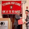 Fitchburg Mayor Stephen DiNatale presents Thepnimith Kiattiack with an award during the FHS Scholars' Banquet on Wednesday evening at the DoubleTree by Hilton Hotel in Leominster. SENTINEL & ENTERPRISE / Ashley Green