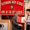 Fitchburg Mayor Stephen DiNatale presents Kevin Ha with an award during the FHS Scholars' Banquet on Wednesday evening at the DoubleTree by Hilton Hotel in Leominster. SENTINEL & ENTERPRISE / Ashley Green
