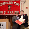 Fitchburg Mayor Stephen DiNatale presents Zachary Hyvarinen with an award during the FHS Scholars' Banquet on Wednesday evening at the DoubleTree by Hilton Hotel in Leominster. SENTINEL & ENTERPRISE / Ashley Green