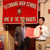 Fitchburg Mayor Stephen DiNatale presents Nhat Tang with an award during the FHS Scholars' Banquet on Wednesday evening at the DoubleTree by Hilton Hotel in Leominster. SENTINEL & ENTERPRISE / Ashley Green
