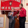 Fitchburg Mayor Stephen DiNatale presents Michael Bourque with an award during the FHS Scholars' Banquet on Wednesday evening at the DoubleTree by Hilton Hotel in Leominster. SENTINEL & ENTERPRISE / Ashley Green
