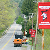 Members of the Fitchburg Parks Department along with the School department hung up banners along Ashby State Road on Thursday help motorist find the high school. SENTINEL & ENTERPRISE/JOHN LOVE