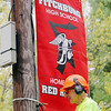 Members of the Fitchburg Parks Department along with the School department hung up banners along Ashby State Road on Thursday help motorist find the high school. John Blanchard the Park's Departments Foreman hangs one of the Banners. SENTINEL & ENTERPRISE/JOHN LOVE