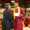Michael Bourque receives his diploma during the 150th Fitchburg High graduation ceremony on Friday afternoon. SENTINEL & ENTERPRISE / Ashley Green