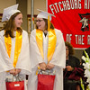 Valedictorian Elizabeth Moison and Salutatorian Claire Grossi receive their awards during the 150th Fitchburg High graduation ceremony on Friday afternoon. SENTINEL & ENTERPRISE / Ashley Green