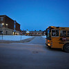 The first school bus arrives in the dark around 6:45 in the morning at Fitchburg High School, Friday.<br /> SENTINEL & ENTERPRISE / BRETT CRAWFORD