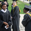 Graduates have some fun while waiting for the start of the 120th commencement ceremony at Fitchburg State University on Saturday afternoon. SENTINEL & ENTERPRISE / Ashley Green