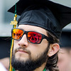 Gustavo Quiros, of Clinton, listens to speakers during the 120th commencement ceremony at Fitchburg State University on Saturday afternoon. SENTINEL & ENTERPRISE / Ashley Green