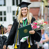 Haylee LaBell, of Leominster, returns to her seat after receiving her degree during the 120th commencement ceremony at Fitchburg State University on Saturday afternoon. SENTINEL & ENTERPRISE / Ashley Green