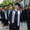 Senior class president Megan Pierce, of Rochester,  is all smiles while walking into the 120th commencement ceremony at Fitchburg State University on Saturday afternoon. SENTINEL & ENTERPRISE / Ashley Green