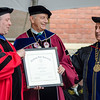 Dr. Daniel Asquino, retiring President of Mount Wachusett Community College, receives the President's Medal during the 120th commencement ceremony at Fitchburg State University on Saturday afternoon. SENTINEL & ENTERPRISE / Ashley Green