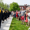 Friends and family line the quad as students enter the 120th commencement ceremony at Fitchburg State University on Saturday afternoon. SENTINEL & ENTERPRISE / Ashley Green