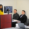 Fitchburg State University student Aimee Mutimukeye gives a presentation in a business course that is running a CEO simulation class, Friday, as students, from left, Tyler Goulding, Jacob Babineau, and Eric deHorsey look on.<br /> SENTINEL & ENTERPRISE / BRETT CRAWFORD