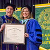 Dr. Nancy Murray receives the Contributions to Graduate Program Award from President Richard Lapidus during the graduate commencement ceremony at Fitchburg State University on Thursday evening. SENTINEL & ENTEPRISE / Ashley Green