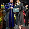 Kelli Rooney, Manager of Public and Community Relations with HealthAlliance Hospital in Leominster, receives her Master of Science degree during the Fitchburg State University graduate commencement ceremony on Thursday evening. SENTINEL & ENTERPRISE / Ashley Green