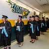 Graduates anxiously await the start of the graduate commencement ceremony at Fitchburg State University on Thursday evening. SENTINEL & ENTEPRISE / Ashley Green