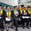 Members of the faculty applaude graduates during the Fitchburg State University graduate commencement ceremony on Thursday evening. SENTINEL & ENTERPRISE / Ashley Green