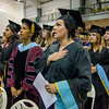 Dawn Marie Ayles, of Lunenburg, stands for the playing of the National Anthem during the Fitchburg State University graduate commencement ceremony on Thursday evening. SENTINEL & ENTERPRISE / Ashley Green