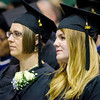 Kelli Rooney listens to speakers during the graduate commencement ceremony at Fitchburg State University on Thursday evening. SENTINEL & ENTEPRISE / Ashley Green