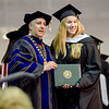 Elizabeth Lough, of Leominster, receives her degree from President Richard Lapidus during the Fitchburg State University graduate commencement ceremony on Thursday evening. SENTINEL & ENTERPRISE / Ashley Green