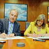 University of Massachusetts School of Law in Dartmouth's Dean and Professor of Law Mary Lu Bilek, on right, and Fitchburg State University President Robert Antonucci sign an articulation agreement that will allow Fitchburg State students to complete their bachelor's and law degrees in a total of six years Wednesday at the FSU.  SENTINEL & ENTERPRISE/JOHN LOVE