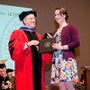 Ellen Goldman receives the Distinguished Scholar Award from Interim Vice President for Academic Affairs during the 39th annual Honors Convocation at Fitchburg State University on Thursday afternoon. SENTINEL & ENTERPRISE / Ashley Green
