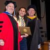 Nat Rojas receives the Outstanding Senior in Computer Information Systems award from Interim Vice President for Academic Affairs Paul Weizer and department chair Brady Chen during the 39th annual Honors Convocation at Fitchburg State University on Thursday afternoon. SENTINEL & ENTERPRISE / Ashley Green