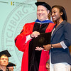 Emmanuella Demosthenes receives the Who's Who Among Students in American Universities award from Interim Vice President for Academic Affairs Paul Weizer during the 39th annual Honors Convocation at Fitchburg State University on Thursday afternoon. SENTINEL & ENTERPRISE / Ashley Green