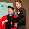 Corey Coleman receives the Who's Who Among Students in American Universities award from Interim Vice President for Academic Affairs Paul Weizer during the 39th annual Honors Convocation at Fitchburg State University on Thursday afternoon. SENTINEL & ENTERPRISE / Ashley Green