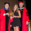Rebecca Bush receives the Outstanding Senior in Early Childhood Education award from Interim Vice President for Academic Affairs Paul Weizer and department chair Ronald Colbert during the 39th annual Honors Convocation at Fitchburg State University on Thursday afternoon. SENTINEL & ENTERPRISE / Ashley Green