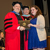 Dominique Saulnier receives the Elaine T Coyne Women in Film Scholarship from Interim Vice President for Academic Affairs Paul Weizer and Dept. Chair Randy Howe during the 39th annual Honors Convocation at Fitchburg State University on Thursday afternoon. SENTINEL & ENTERPRISE / Ashley Green