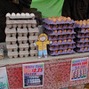 Flat Stanley buying fresh eggs at the Farmers Market.