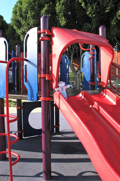 Flat Stanley on the slide at Victoria Manalo Draves Park in San Francisco