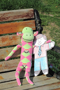 Flat Stanley and his new friend, Paul Frank, sock monkey