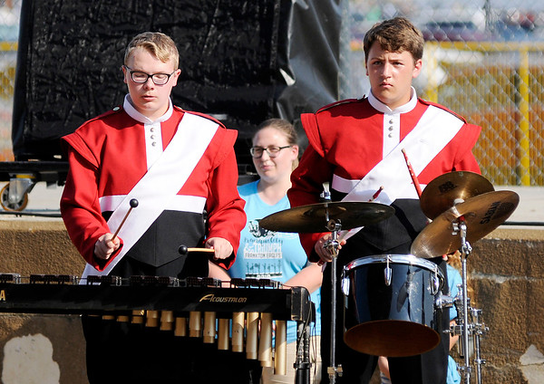 Don Knight | The Herald Bulletin<br /> From left, Ryan Mattingly and Collikn Riley perform with the Marching Eagles during Indiana State Fair Band Day on Saturday.