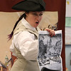 Freedom Trail Scholars Program visits McAuliffe Elementary School for a program reenacting events that led up to the Revolutionary War. Arielle Kaplan exhorts the crowd about the Boston Massacre. (SUN/Julia Malakie)